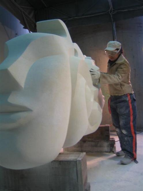 Jin Lee works on an Oamaru stone sculpture in her Korean studio.
