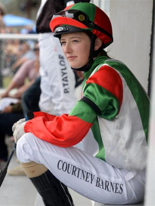 Jockey Courtney Barnes wears a black armband  in honour of Ashlee Mundy at the Waikouaiti races...