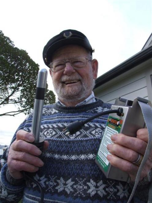 John Brown holds a Newtek Pacifier, which he has been selling to dairy farmers in North Otago....