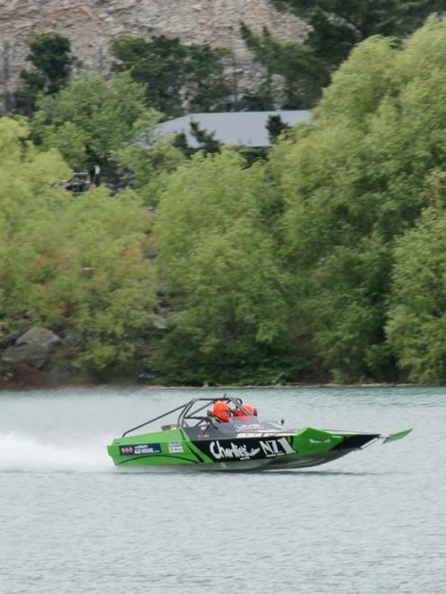 John Derry crosses the finish line  at Cromwell yesterday to win the World Jet Boat Marathon....