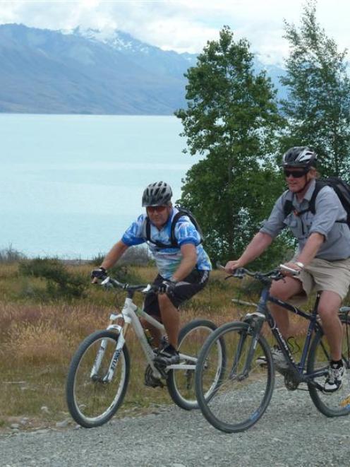 John Dunn (left) and Alps 2 Ocean chairman Mike Neilson ride the Pukaki section of the Alps 2...