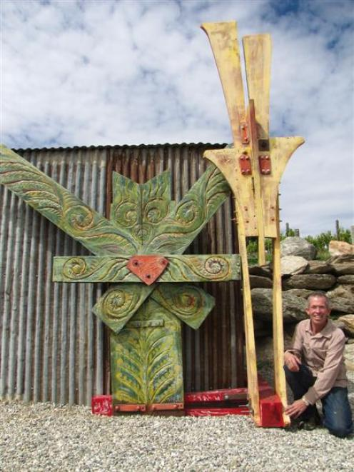 """John Herbison with his piece Caitanya  """"The Living Force"""", in memory of the Christchurch..."""