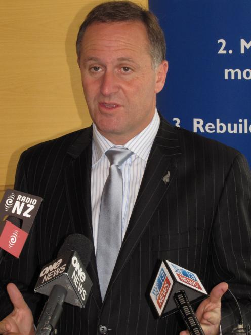 John Key answers questions in Queenstown today. Photo by James Beech