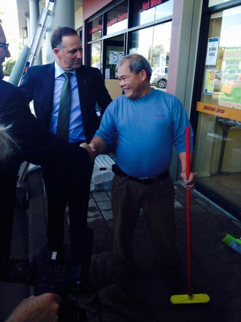 John Key met flood-hit business owners in Christchurch this morning. Photo from @johnkeypm