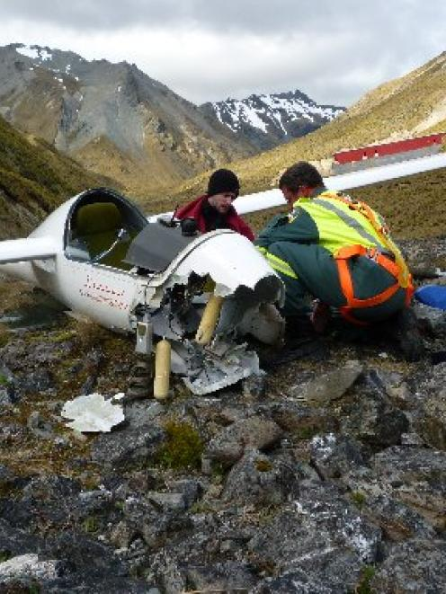 "John Lambeth treats injured glider pilot Alex Marshall after a ""heavy landing"" 35km west of..."