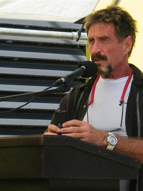 John McAfee is seen speaking in San Pedro, Belize, last week. McAfee says he has gone into hiding...