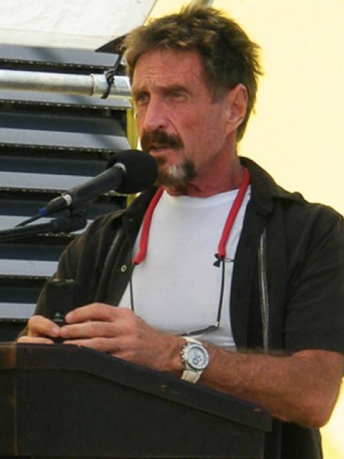 John McAfee says police in Belize want to frame him for the murder his neighbour Gregory Faull....