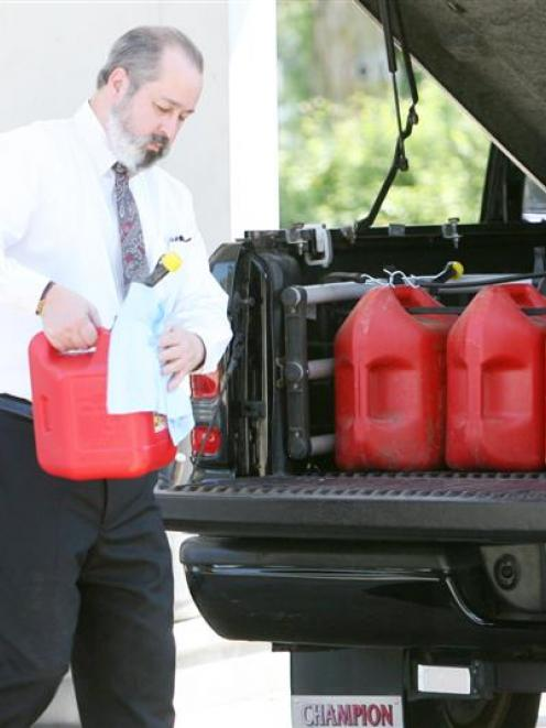 John McDonnell of Biloxi, Mississippi, stocks up on gasoline in anticipation of Tropical Storm...