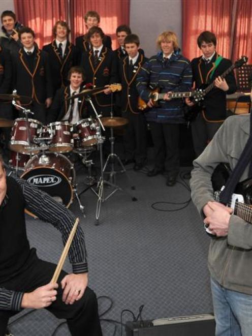 John McGlashan College head of music Bruce James (left) and music teacher Brad Martin with pupils...