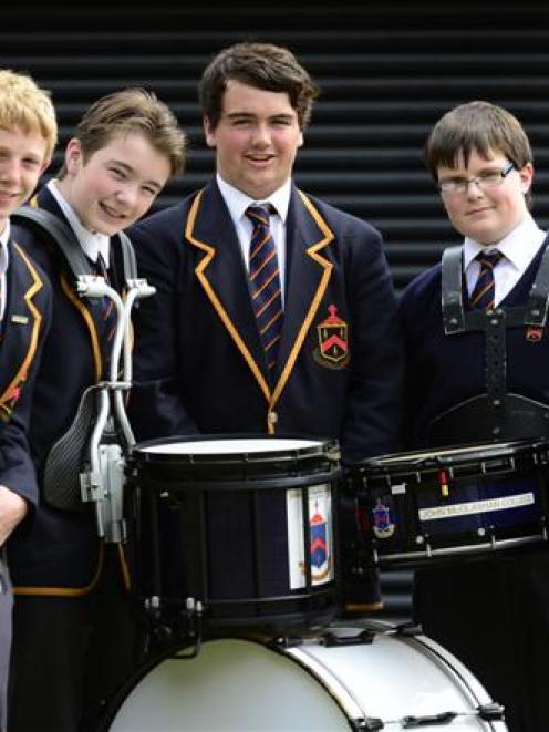 John McGlashan College Pipe Band members (from left) Sam Darling (14), Joe Corbett (15), Campbell...