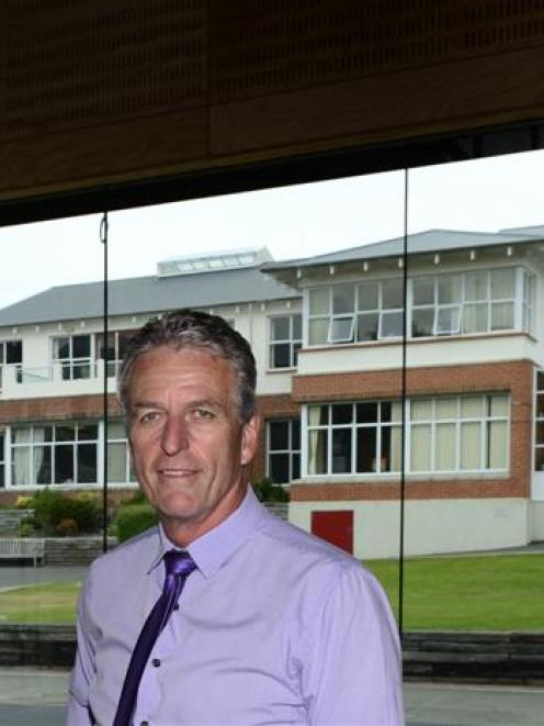 John McGlashan College principal Mike Corkery admires the inside of the school's new gymnasium,...