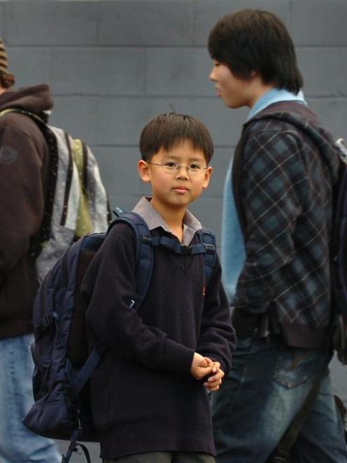 John McGlashan College pupil Semin An (11, centre) models a Chiropak school bag which helps keep...
