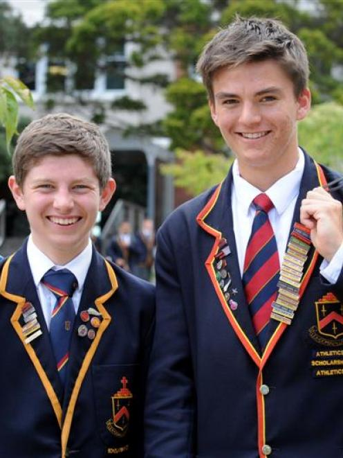 John McGlashan College pupils Andrew Logie (left) and Ed Davies smile after receiving  McGlashan...