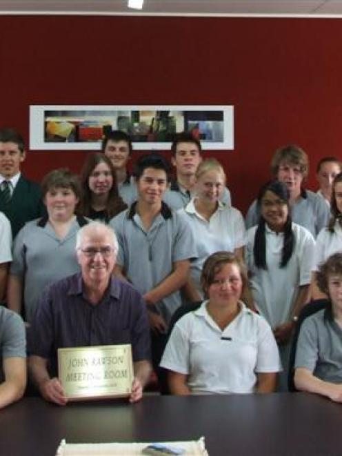 John Rawson (front centre) with the East Otago High School pupil council in the meeting room...