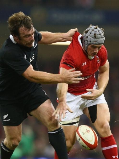Jonathan Davies (right) of Wales spills the ball under the challenge of Andrew Hore of New...
