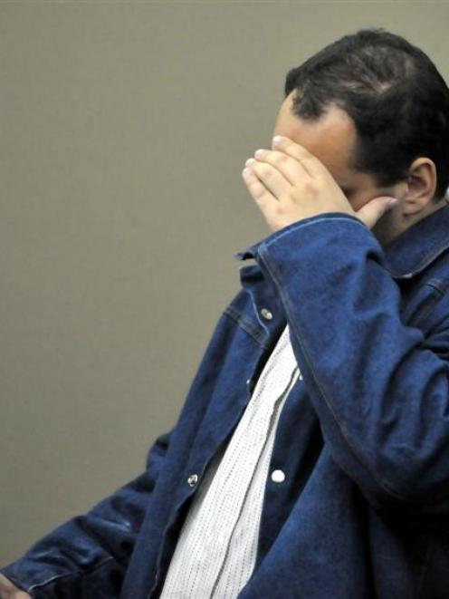 Joseph Lepper hides from the camera in the High Court at Dunedin while pleading guilty to a sex...