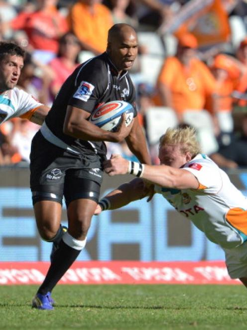 JP Pietersen of the Sharks on the charge against the Cheetahs in their Super 15 match at Free...