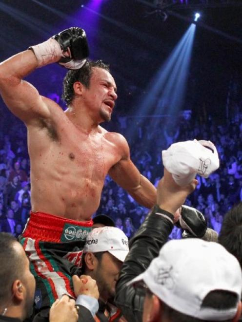 Juan Manuel Marquez of Mexico celebrates his knockout victory over Manny Pacquiao of the...