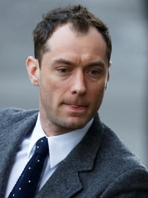 Jude Law arrives to give evidence at the Old Bailey courthouse in London. REUTERS/Suzanne Plunkett