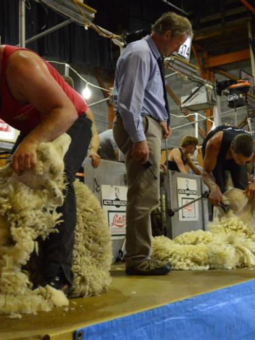 Judge Grant Bradfield (centre) oversees shearers Gareth Daniel (left, Wales) and Rowland Smith ...