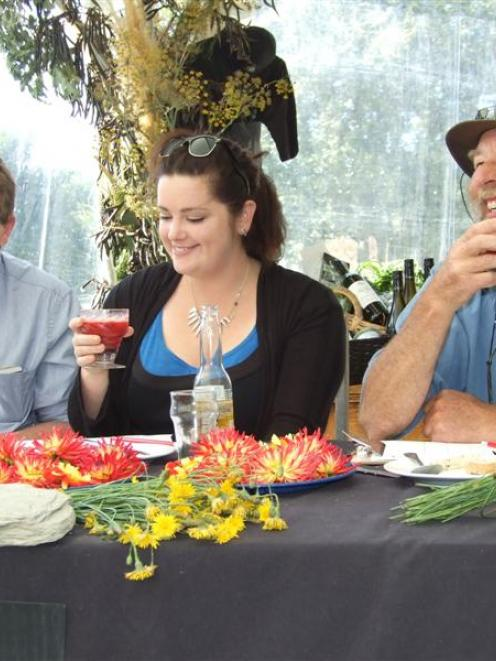 Judges Greg Piner (left), Rachel Holmes-Libbis and Mark Hasselman enjoy stinging nettle-infused...