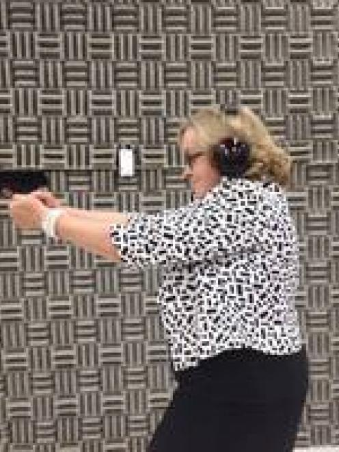 Judith Collins firing a gun in a photo uploaded to her Facebook page.