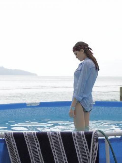 Juliet  (Derya Parlak) contemplates love in a small pond.