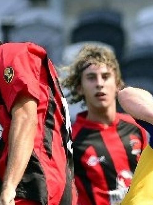 Julyan Collett and Louie Bush, of Canterbury United, and Regan Coldicott, of Otago United,...