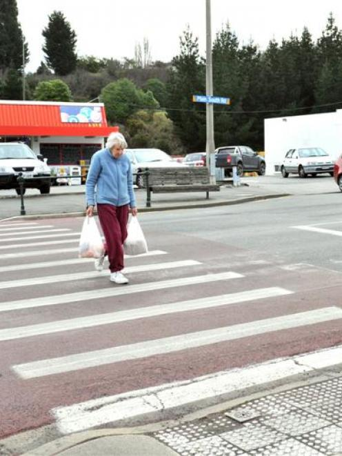 June Evans, of Green Island, walks on a recently painted crossing in Green Island. Photo by Linda...