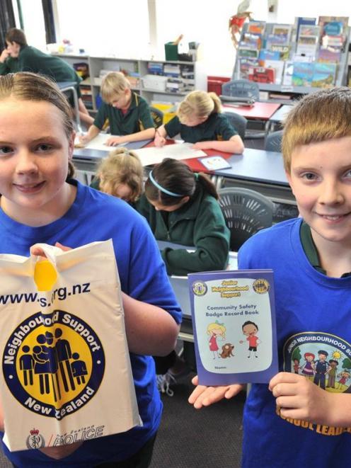 Junior Neighbourhood Support leaders Brianna Reid (12, left) and Baily Cavanagh-Welch (12) hold a...
