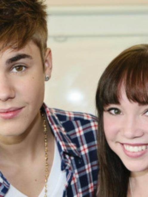 Justin Bieber, pictured with Starship patient Makenzie Perry, is helping to promote the hospital...