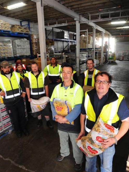 Kaan's Catering owners Lindsay (front right) and Geoff Kaan in their Willis St warehouse with...