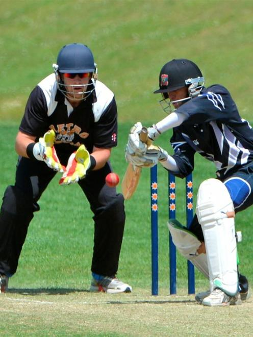 Kaikorai batsman Saj Senadeera looks to guide the ball through the off side during the Otago...