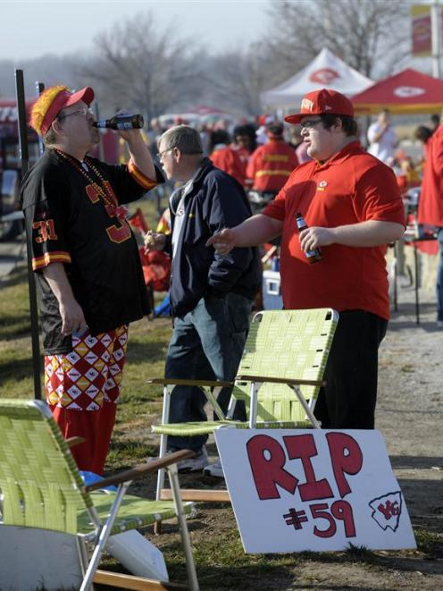 Kansas City Chiefs fans Kurt Gant (left) and his son, Taylor, have a makeshift memorial for ...