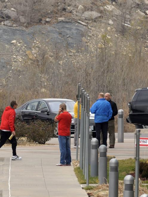 Kansas City Chiefs staff stand outside the team's practice facility following an apparent murder...