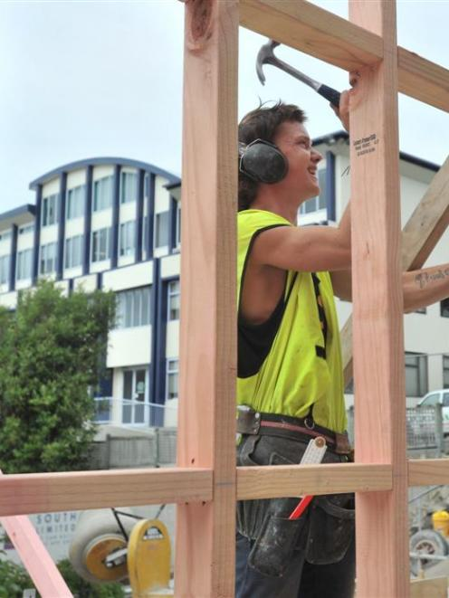 Karl Leishman, of Lund South, braces wall framing of the Otago Regional Council's new council...