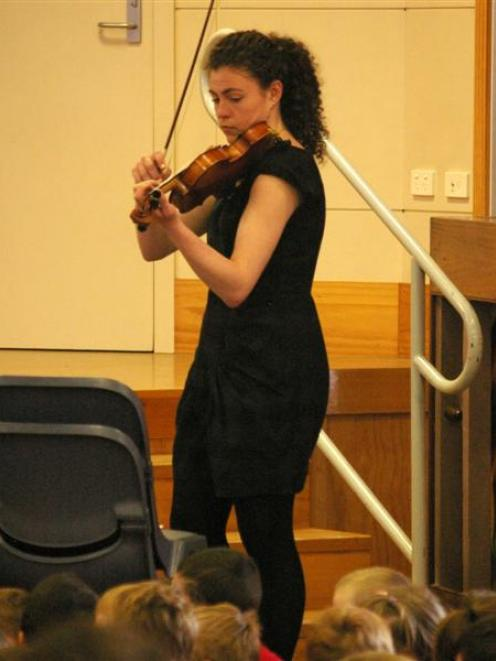 Karla Norton demonstrates the short, percussive notes of pizzicato on Wednesday. Photos by Hamish...