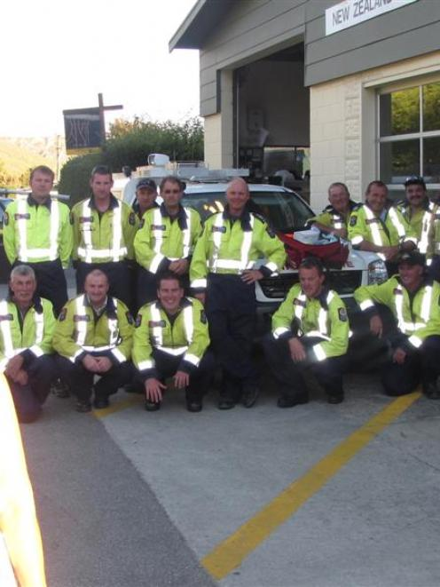 Kate Dawson, of Altrusa Queenstown, with some of the members of the Arrowtown Volunteer Fire...