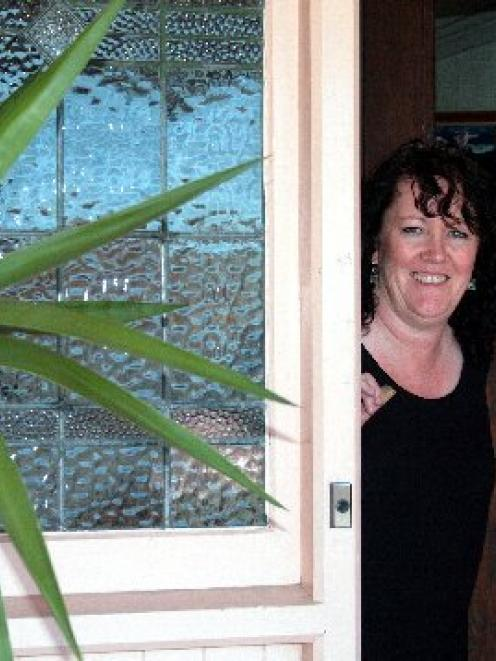 Kathy Scott enjoys the warmth of her new home after getting the cost of installing insulation and...