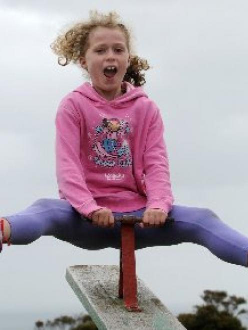 Katie St Clair Newman (8), of Grant Braes School in Dunedin, enjoys some after school outdoors...