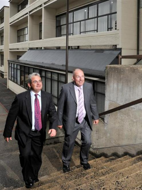 Kavanagh College principal Paul Ferris (right) shows his replacement, Tracy O'Brien, around the...