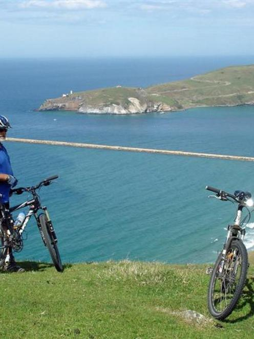 Keith Munro takes in the view from the top of the Heyward Pt track with the Mole and Taiaroa Head...