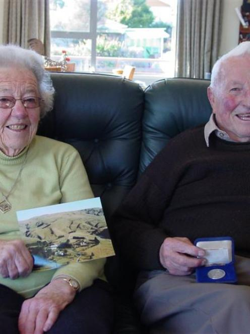 Keith Philip (87) holds the champion fleece medal he received in 1988 from the Royal Agricultural...