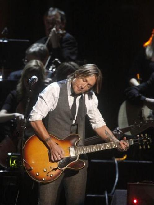 Keith Urban performs in a tribute to Glen Campbell at the 45th Country Music Association Awards...