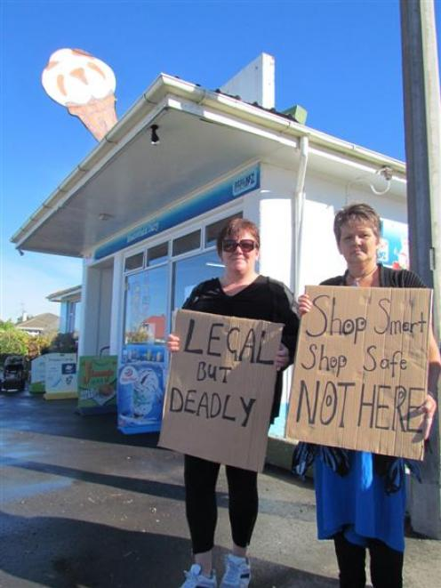 Kelly Cadogan (left), and Linda Forbes continue with their protest outside an Oamaru dairy...