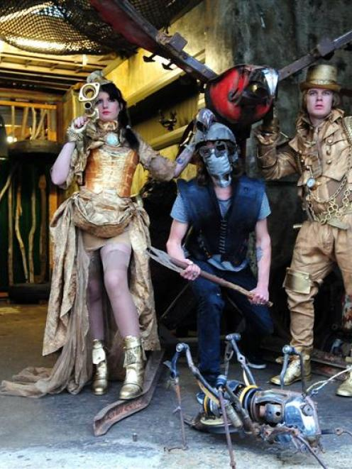 "Kelsi Herrick, Matt Lyng and Josh Bennison model ""steampunk"" outfits designed by Chris Meder and..."