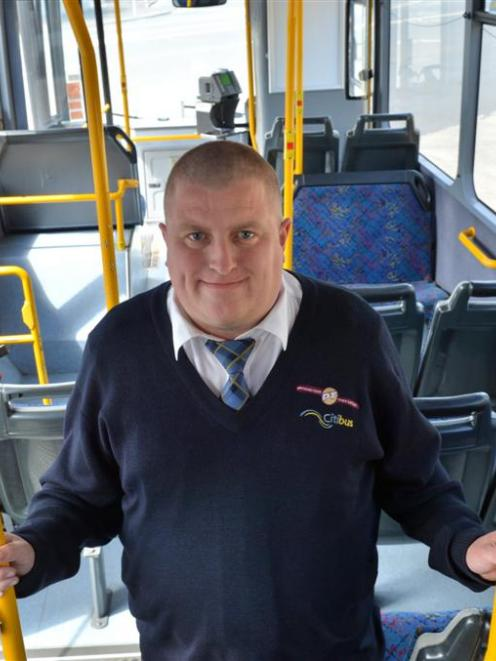 Kelvin McHardy inside the Passenger Transport city bus he will drive during the National Summer...