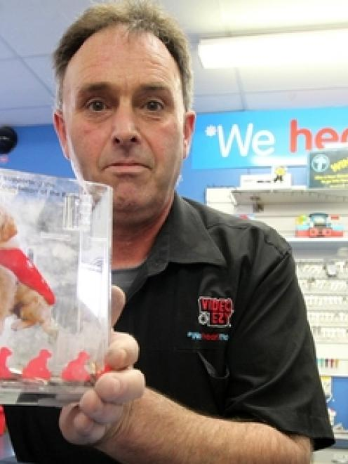 Kevin Knox, owner of Video Ezy Greenmeadows, Napier, with a charity donation box for the Royal...
