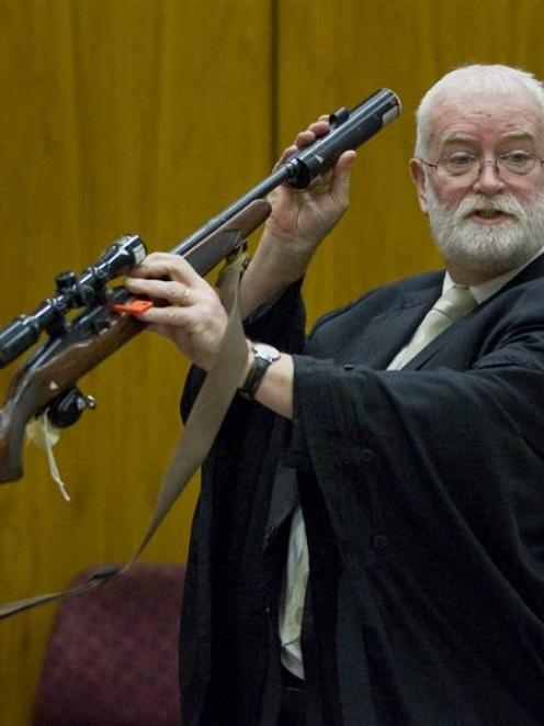 Kieran Raftery QC (above) explains that Stephen Bain left fingerprints on the murder weapon while...