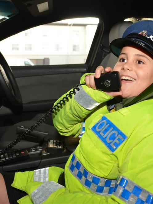 Kieran Rotarangi (9), of Dunedin, sees if the job fits during the New Zealand Police Open Day at...